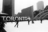 Toronto on Ice (Georgie_grrl) Tags: nathanphillipssquare skating icerink winter skaters cold fun friends family pentaxk1000 rikenon12828mm jchstreetpan400 blackandwhite monochrome toronto ontario sign mapleleaf