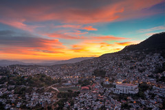 Taxco at sunset (photographyzimbo) Tags: 2017 201701 color gear mexico sonyalpha7rii taxco when why zeissbatis25mmf20 architecturalphotography blue building camera clouds colorimage colourimage daytime hdr holidays lamp landscape landscapephotography lens light mountain naturephotography nightphotography orange purple red seasons sunset violett warmcolors weekendtrip wideangle winter yellow