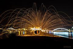 Come into my world of fire (ElmerstarK) Tags: longexposure lightpainting france fire lyon rhône spark fr feu confluence saône longueexposition rhônealpes étincelle