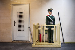 China: Standing Still #2 (laskaproject) Tags: china portrait man yellow standing underpass underground uniform asia military guard beijing young police communism onguard