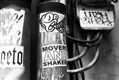 Movers And Shakers (35mm) (jcbkk1956) Tags: street blackandwhite film 35mm thailand mono nikon wiring bangkok stickers cables manual nikkor posts shakers movers moversandshakers