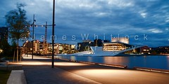 Oslo Harbour (James Whitlock Photography) Tags: city blue house reflection tourism oslo norway night sunrise canon opera alone theatre harbour walk centre visit illuminated hour 7d