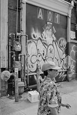 A 0 1 (geowelch) Tags: street urban toronto blackwhite chinatown rangefinder 35mmfilm xp2super400 honeywellvisimatic615 streetlevelphoto plustekopticfilm7400