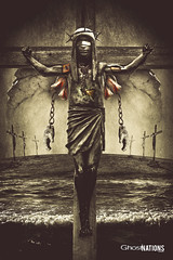 The First Immortal (The Clockwork Savior) (Ghost Of Nations Photography And Digital Art) Tags: ghostofnationsphotography ghostofnations gloomy dark disquiet disturbing statue haunting eerie crucifix crucifixion crown blindfold chains stone hands liminal