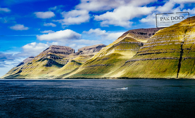 A man fishing in the fjord of Kunoy - Faroe Islands
