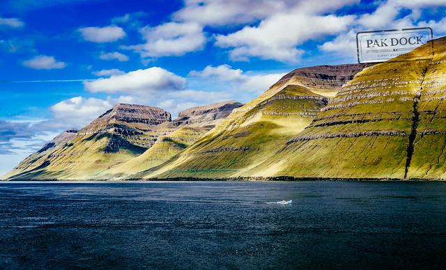 A man fishing in the fjord of Kunoy - Faroe Islands