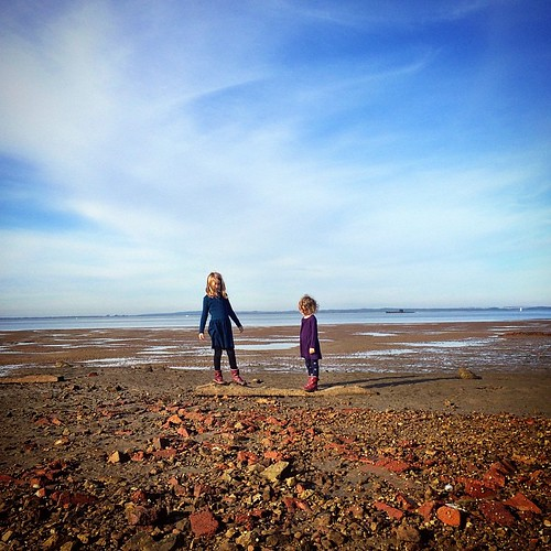 153/365 • the Smalls - as far out as they could get without entirely soaking their shoes. And that is a submarine in the background on the right, naturally • #153_2015 #7yo #4yo #thisafternoon #cribpoint #submarine #sky #beach #Winter2015 #morningtonpenin