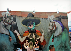 """Gypsy with Stallions"" (Robert S. Photography) Tags: park nyc summer horses people streetart art brooklyn canon painting coneyisland amusement iso200 display powershot seats tables talking stallions gypsy 2015 coneyartwalls elph160"