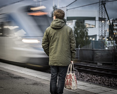 Commuter (Henka69) Tags: commute train trainstation solna street streetphoto streetcolour