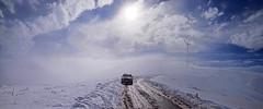 ADVENTURE (GEORGE TSIMTSIMIS) Tags: car jeep road outdoors fog clouds mountain white mud blue brown pentaxk1 ricohimaging full format panoramic windmills high adventure fullframe winter achaia patras greece