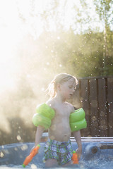 Summerlight (Dalla*) Tags: boy portrait playing color water children outside iceland kid colours child play hottub floaters wwwdallais waterpistole