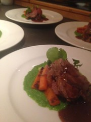 Rosemary roast leg of lamb served with thyme buttered carrots, dauphinoise potatoes, pea and mint puree and a rich red wine gravy- served up beautifully by Chalet L'isiere's Evie!