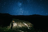 Stars over the abandoned house (Alex Karamanov) Tags: mountains landscape light mood atmosphere outdoor color travel nature surreal contrast trip hill mountainside ridge edge dawn melancholy tranquility sky clouds mountain town city night nightscape lights nightsky stars cold milky way peaks abandoned caucasus calmness house black background abstract texture minimalism