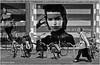 Walking Ladies (Hindrik S) Tags: ladies women froulju dames vrouwen damen frauen gstarraw billboard commercial street straat strjitte streetphotography straatfotografie running rek fietsenrek candid shopping winkel shop laden stad city cityscape urban blackandwhite zwartwit swartwyt sonyphotographing sony sonyalpha a57 α57 slta57 tamron tamronspaf1750mmf28xrdiiildasphericalif leeuwarden liwwadden ljouwert 2015 monochrome