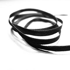 ribbon (vertblu) Tags: ribbon bw mono highkey black blackwhite coiled rolledup minimal minimalism minimalismus 500x500 bsquare kwadrat vertblu study light lightshadow macromode macro makro texture texturesquared textures textur graphical graphic dof