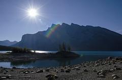 Lakeside Morning DSL4184 (iloleo) Tags: lake alberta banffnationalpark sun morning landscape mountains scenic nature nikond7000 canada shoreline rocks lakeminnewanka