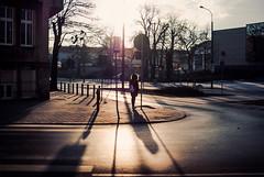 looking down the cross (ewitsoe) Tags: cold winter walk chill woman erikwitsoe ewitsoe nikond80 35mm street city life poznan polandd wintery walingpolska citylife urban sun awn sunrise