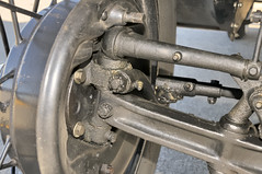 Solid-axle front suspension, 1928 Ford Model A - Toronto Queensway (edk7) Tags: auto cruise toronto ontario canada classic car vintage automobile mechanical steel machine engineering vehicle 1928 kingpin queensway forging brakelever bolthead locknut wirewheel 2013 greasenipple brakedrum cotterpin solidaxle 1928fordmodela nikond300 steeringrod edk7 rightfrontsuspensionassembly