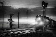 Chicago Bound (ShutterJack) Tags: light urban blackandwhite santafe monochrome electric fog night rural train twilight nikon track moody crossing dusk engine atmosphere rail eerie locomotive bnsf 8077 jameshale intermodalfreight jimhale shutterjack