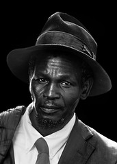 Portrait (D80_462857) (Itzick) Tags: telavivdec2016 blackbackground bwportrait man candid d800 itzick hat tie