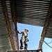 Sailors repair a classroom roof in Honduras.