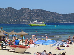 Sailing and beach with back ground (Jean Bloor) Tags: glass boat bottom cala majorca millor beachpeopleseahillssunshineparasolsdeckchairs