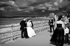 Dark Clouds On The Horizon (nigelhunter) Tags: wedding sea sky guests clouds groom bride horizon photographs shore promenade morecambe