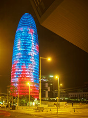 Torre Agbar at night and the Museu de Disseny (wirehead) Tags: em5mk2 20mm torreagbar architecture night city