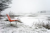 Ringside Seat – Sony A7r (magnus.joensson) Tags: sweden swedish skåne svedala winter snow snowing lake chair red empty sony a7r zeiss loxia 21mm digital landscape white