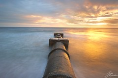 Sewer Pipe | Williamstown Beach (Jake Richardson Photography) Tags: melbourne victoria australia williamstown beach pipe sewer shellys pavilion water ocean sea smooth clouds grey sunset colour color sun orange reflection blue sky long exposure le nikon d610 nisi 10 stop nd