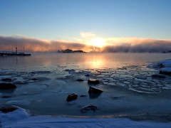 The fire and ice of a freezing morning (KaarinaT) Tags: ice sea dawn morning winter freezing freezingweather helsinki finland kaivopuisto sunrise fog seafog snow rocks