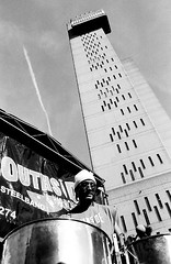 Trellick Tower, steel drums (Stephen Dowling) Tags: bw london film monochrome blackwhite nottinghillcarnival canont90 ilfordfp4