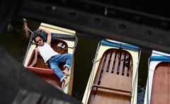 Rob, Relaxing Under the Bridge (Zek Kelley) Tags: thailand boat southeastasia saveme deleteme10 sleep kanchanaburi