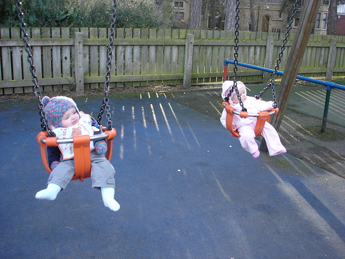 Oliver and Niamh on the swings