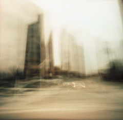Metropolis (nicolai_g) Tags: color building film blurry 40mm grainy spacetime