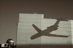 shadow on the wall (duesentrieb) Tags: shadow urban blackandwhite bw berlin art monochrome wall architecture germany painting airplane deutschland mural europa europe cityscape synagogue architektur disturbing schwarzweiss mitte tumblr