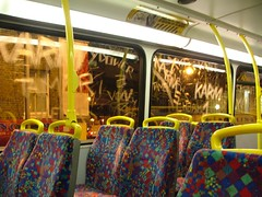 Etched windows on an N89 (Nicobobinus) Tags: london graffiti etching deptford nightbus londoncentral n89