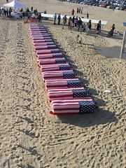 Coffins draped in flags, Santa Monica Beach (Eleventh Earl of Mar) Tags: park usa sunlight beach dead soldier pier bush santamonica flag iraq cheney soldiers coffin iraqwar coffins 4000 impeachbushnow 750000 cilvilians