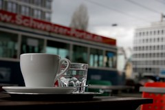 Easter Sunday (afternoon) (Dreamer7112) Tags: street city urban 20d water glass coffee easter outside schweiz switzerland europe dof suisse suiza coffeecup canon20d zurich citylife streetphotography favorites tram canoneos20d e views sua zrich svizzera trams zuerich sr eos20d coffeshop urbanlife coffeecups damncool alphabetsoup eastersunday zurigo urbanite vbz sr108 sphres interestingness385 i500 a1f1   vision1000 visiongroup  vision100 reflectyourworld streetsofmine milobaumgartner