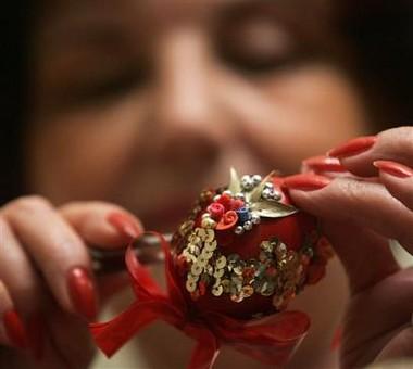 Marija Jozanov decorates an egg for Easter, on Orthodox Holy Thursday