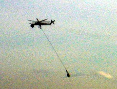 Helicopter Towing Something (Pixel Packing Mama) Tags: cool action helicopter oddtransportation skycrane drivebyshooting artnolimits v200 cooloutdoorpics 111v1f femalephotographers pixelpackingmama lucidmysterious dorothydelinaporter canonpowershota510a520 worldsfavorite cameraactionnotastilllife adventuresinflying favoritedpixset airplaneshelicoptersset uploadedfirsthalfof2006set pixelpackingmama~prayforkyronhorman oversixmillionaggregateviews over430000photostreamviews
