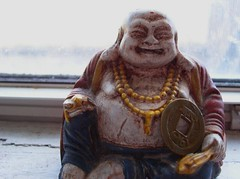 Hotei, the Laughing Buddha (with coin)