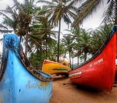 Goan fishing boats (Java Cafe) Tags: blue red india topf25 colors yellow boat interestingness fishing topf50 500v20f goa vivid 100v10f fishingboat f50 interestingness132 i500 gtaggroup goddaym1 explore29apr06 fivestarsgallery