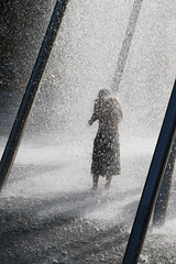 Drenched (Lil [Kristen Elsby]) Tags: park boy shadow urban wet water fountain silhouette child play sydney australia spray topv5555 getty splash olympicpark topf250 homebush gettyimages drenched australasia oceania torrential gettyimagesonflickr