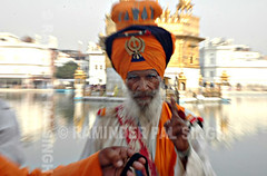God Is One!  (#5 on Explore 5 May 2006) (Raminder Pal Singh) Tags: india water horizontal beard temple one golden respect god zoom faith religion belief explore sikh punjab amritsar sikhism saffron attire thepca zoomburst khanda nihang