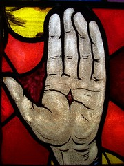 Stained hand, stained glass (yerffej9) Tags: windows red pierced favorite church glass stain colors topv111 easter interestingness blood hands topv333 colorful hand christ unitedstates jesus stainedglass piercing stained explore northamerica stigmata piercings stigma crucifixion symbolism jesuschrist crucify interestingness88 yerffej9 flickrcolorcontest jeffrozema