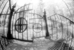gates to........ (paddyjoe) Tags: blackandwhite bw film spring nikon graveyards cemetary fisheye infrared paths kodakhie top20ir tccomp221