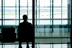 Waiting (Andrew.) Tags: shadow toronto canada man glass silhouette canon 1 airport waiting terminal 1855mm pia patience yyz terminal1 pearsoninternationalairport canon1855mm