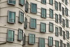 Windows (smiling_da_vinci) Tags: windows building texture lines wall reflections prague xx curves echo shapes x repetition devilish topv666 dancingbuilding czechia reps gingerandfred topf40 20f takeacloseupofthewindowsshesaid byarchitectfrankgehryawardedthepritzkeprizeandtimesawardforit