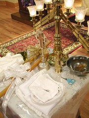 Baptism and Chrismation needs (zenosaurus) Tags: baby greek babies monk baptism holy orthodox orthodoxchristian greekorthodox chrismation hieromonk